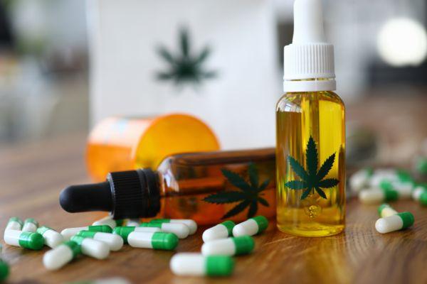 CBD oil vials and some pills